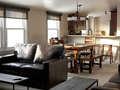 A spacious and sunny eating area and living room are a great place to relax.