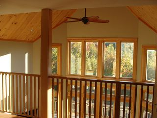 West Wardsboro house photo - A bright view from balcony overlooking 27' high Cathedral Ceiling Living Room.