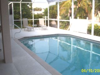 Vacation Homes in Marco Island house photo - extra large pool deck for sunbathing