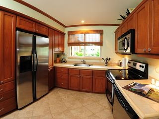 Playa Herradura condo photo - Fully equipped kitchen plus stackable washer/dryer.