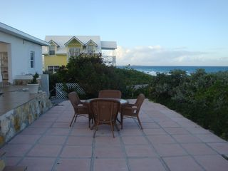 Great Exuma house photo - Backyard Patio overlooking the beach