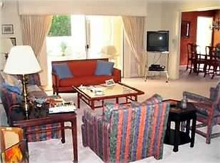 Well furnished, spacious living room and view of Dining Room