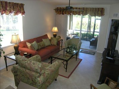 Living Room with a southwestern view of the golf course -- 40' flat-screen TV.