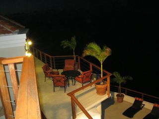 Northside villa photo - Evening deck, relax with a glass of wine