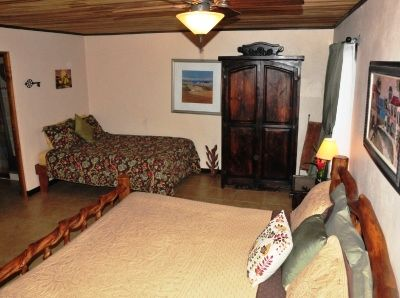 Queen Bed & Armoire which has towels