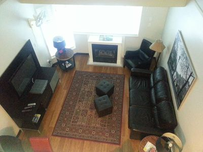 Bright living room, vaulted ceiling.  TV, stereo, free wi-fi, fireplace.