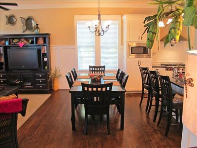 Large kitchen table with breakfast area close by.