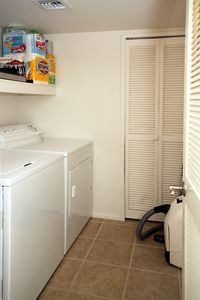 Large utility room for washer and dryer, vacuum, supplies and your equipment