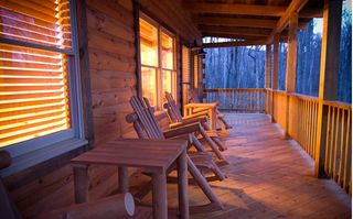 Stanardsville cabin photo - Spacious, well lit deck with rocking chairs view the rear of the property.