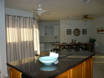 Kitchen Island and Dining Room.