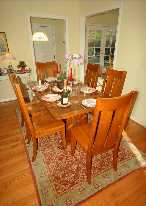 Charming dining area comfortably accommodates six.