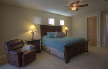 Comfortable recliner in 1st Master bedroom, & fine linens.