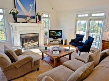 Sunny Living Area Has Fireplace & Room to Entertain