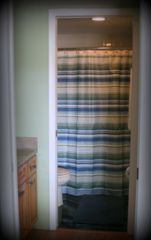 Indian Shores condo photo - The Master Bathroom features a Tub/Shower Combo and pocket doors for privacy.