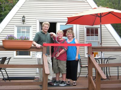 Owner-Hosts Mary and George with son, Evan, at opening ribbon cutting ceremony