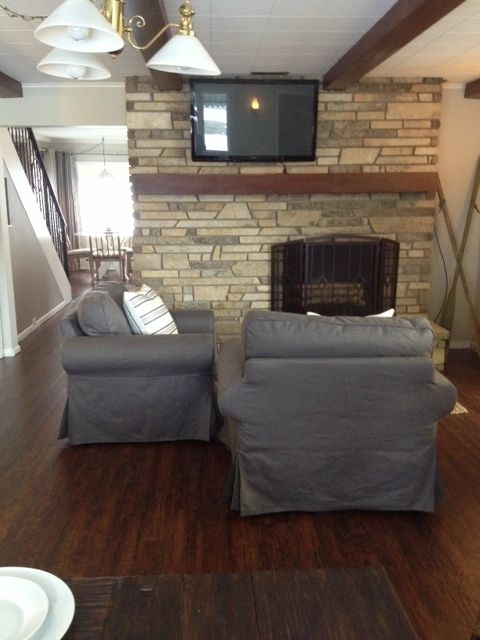 Kitchen seating area with fireplace and flat screen TV.