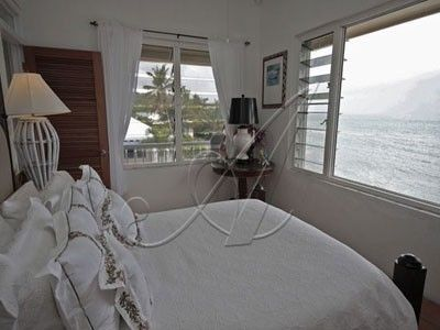 Upper level bedroom in the guest house with water view