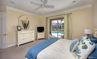 "Vacation Homes in Marco Island house photo - Master with 32"" HDTV, DVD, and Pool Access!!"