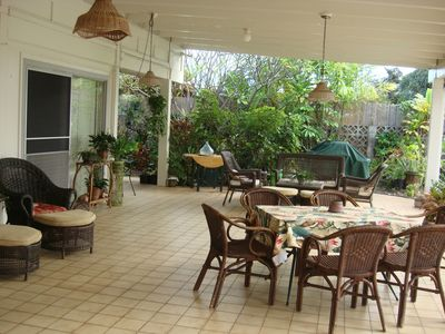 Lots of seating to enjoy meals or the shade of a covered lanai next to the pool