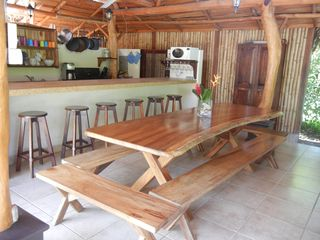 Nosara house photo - Dining room table in the Rancho seats up to 14 people plus six counter stools