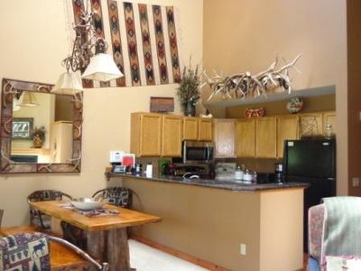 Kitchen/Dining Room with granite, new appliances and antler chandelier.