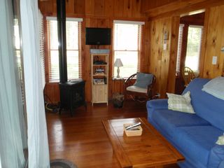 West Yarmouth cottage photo - Sunroom: flat screen tv, cable, DVD, internet, sliding door to deck