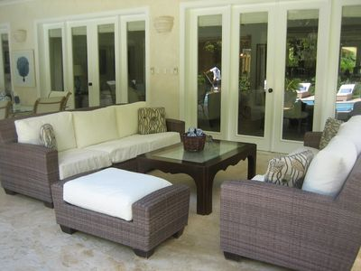 Outdoor living area adjacent to pool