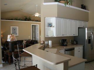 Vacation Homes in Marco Island house photo - Stainless Kitchen w/ breakfast bar & nook overlooks pool, lagoon