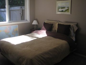 second bedroom on main floor with comfy queen bed