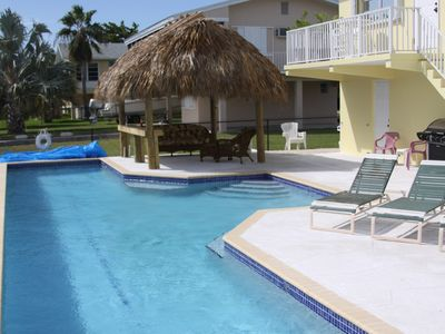 Awesome lap pool with massage seats, lounge area and Tiki with bar