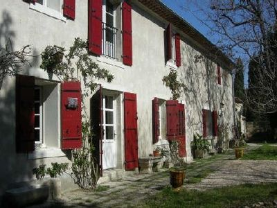 large traditional farmhouse at the foot of the Alpilles