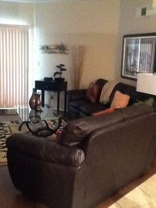 Great room with leather sofa, loveseat and TV (not pictured)