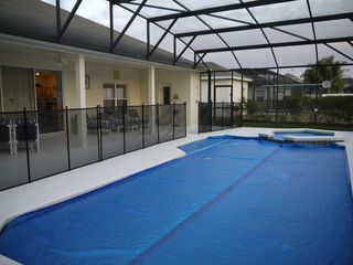 Champions Gate villa photo - Safety fence and pool blanket in place