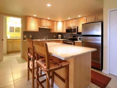 Fully Stocked Kitchen with Granite Countertops and Stainless Steel Applicances