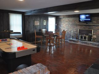 Niagara Falls estate photo - game room with wood burning stove and hanging plasma tv