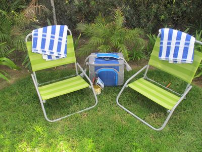Beach chairs, towels, cooler and the first bottle of wine for guests!