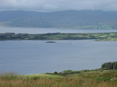 The house (lower center) is on the shore of 22 mile-long Bantry Bay