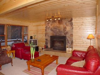 Crystal Mountain, Thompsonville cabin photo - Second-floor living room looks out to the pines.
