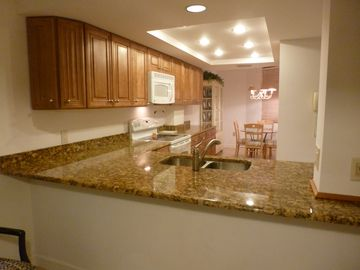 UPDATED, FULLY EQUIPPED KITCHEN, GRANITE COUNTER TOPS AND MAPLE CABINETS