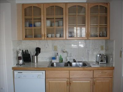 A renovated kitchen and dining/cook ware plus dishwasher