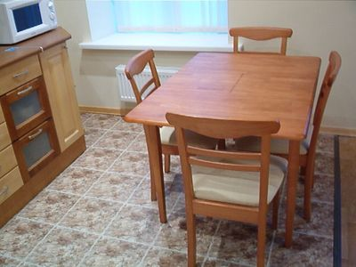 Kitchen Table, wood not veneer with cushioned chairs, Table can seat four