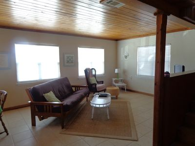 Living area w/ a Futon/sofa area with large screen tv/dvd/wireless/games/stereo