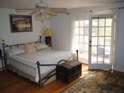 Master Bedroom with king size bed and French doors leading to private porch