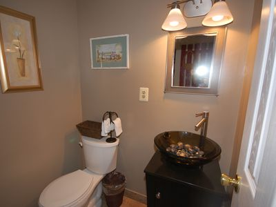 1st Floor 1/2 bath. Full bath located on the second floor