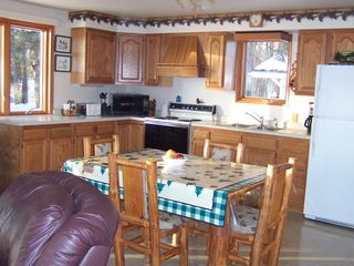 Winter house photo - Fully stocked kitchen. Open concept keeps everyone together.