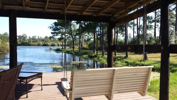 Slidell house rental - Imagine a cup of coffee out on the porch swing in the mornings!