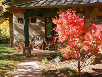 Sedona house rental - Fall colors and our comfy front porch and antique family heirloom rocking chair
