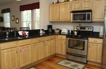 Fully equipped kitchen with granite counter tops and top of the line appliances