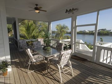 Relax and dine on large screened porch