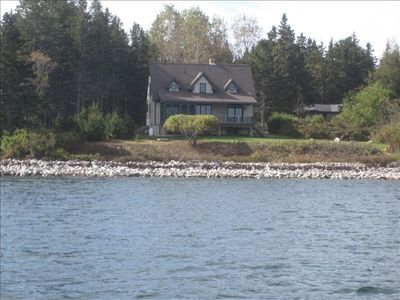 Shorefront location with spectacular views of islands and mountains.